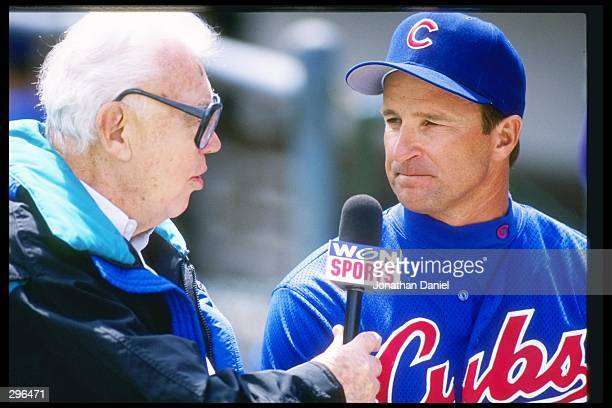 Manager Jim Riggleman of the Chicago Cubs speaks with reporter Harry Caray during opening day at Wrigley Field in Chicago Illinois Mandatory Credit...