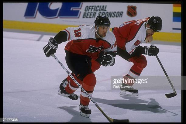 Philadelphia Flyers defenseman Shawn Antoski and rightwinger Mikael Remberg moves down the ice during a game against the Buffalo Sabres at Memorial...