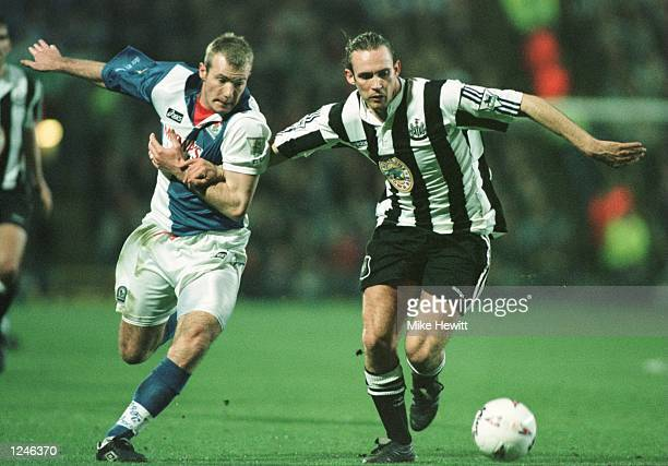 Alan Shearer of Blackburn challenges Darren Peacock of Newcastle during the Blackburn v Newcastle Premier League Match played at Ewood Park in...