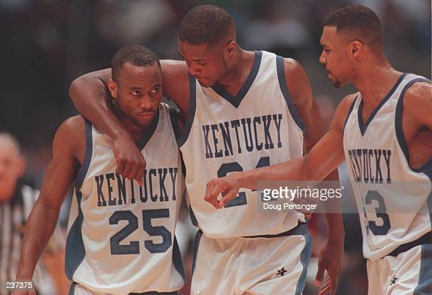 Anthone Epps Antoine Walker and Ron Mercer of the Kentucky Wildcats talk together during the final of the1996 NCAA Final Four Men''s Basketball...