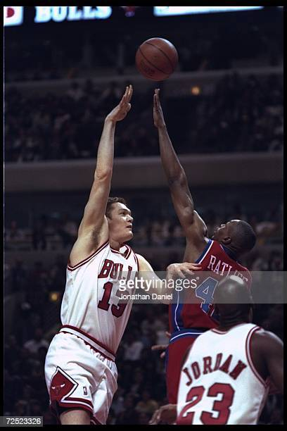 Center Luc Longley of the Chicago Bulls goes against forward Theo Ratliff of the Detroit Pistons during a game played at the United Center in Chicago...