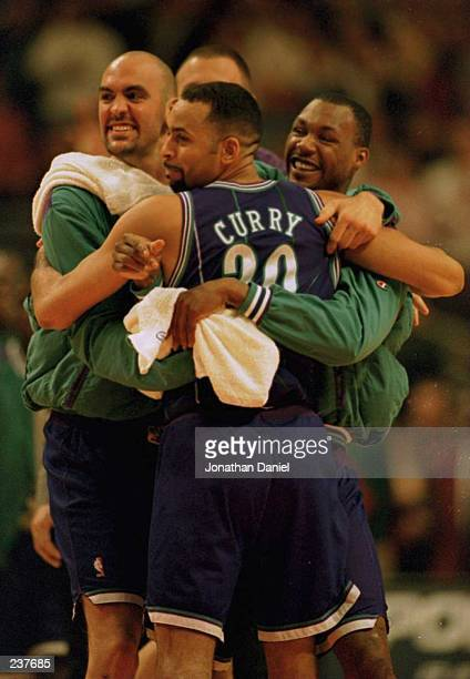 Charlotte Hornets center Matt Geiger and guard Darrin Hancock hug guard Dell Curry following Charlotte Hornets win over the Chicago Bulls the first...