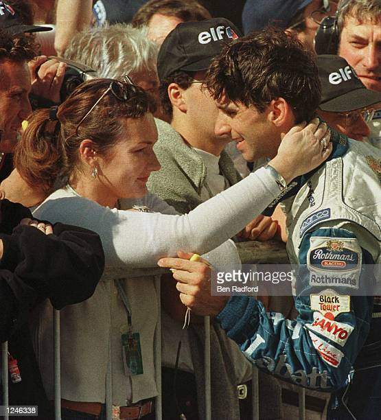 Damon Hill of Great Britain and the Williams team celebrates with his wife Georgie after winning the Argentine Formula One Grand Prix in Buenos Aires...