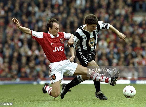 David Platt of Arsenal tackles Peter Beardsley of Newcastle United during an FA Carling Premiership match at Highbury Stadium in London Arsenal won...