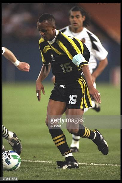 Doctor Khumalo of the Coumbus Crew fights for the ball during an MLS game against the New York/New Jersey Metrostars playued at the Meadowlands in...