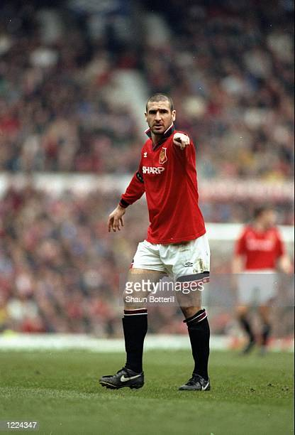 Eric Cantona of Manchester United indicates to his team mates during an FA Carling Premiership match against Coventry City at Old Trafford in...