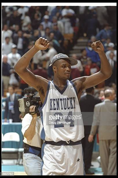 Forward Antoine Walker of the Kentucky Wildcats celebrates during a game against the Syracuse Orangemen at the Meadowlands Arena in East Rutherford...
