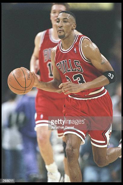Forward Scottie Pippen of the Chicago Bulls dribbles the ball down the court during a game against the Milwaukee Bucks at the Bradley Center in...