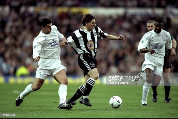 Gary Speed of Leeds United holds back Peter Beardsley of Newcastle United during an FA Carling Premiership match at Elland Road in Leeds England...