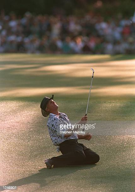 Greg Norman of Australia collapses on the ground after narrowly missing his chip shot on the 15th green during the final tound of the 1996 US Masters...