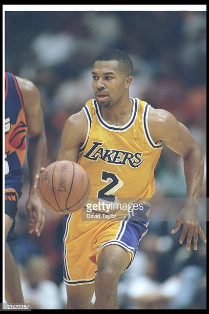 Guard Derek Fisher of the Los Angeles Lakers moves the ball during a game against the Phoenix Suns at the Great Western Forum in Inglewood California...