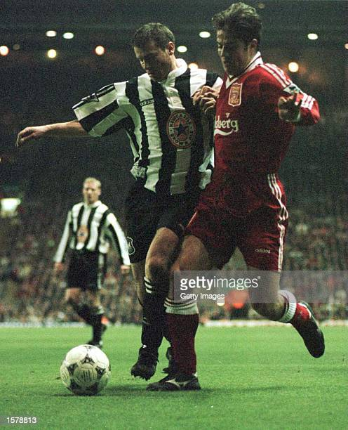 Jamie Redknapp of Liverpool battles for the ball with Robert Lee of Newcastle United during their FA Premiership game at Anfield Liverpool Mandatory...