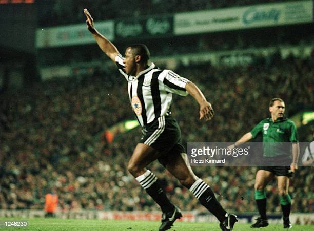 Les Ferdinand of Newcastle celebrates after scoring the equaliser against Liverpool during their FA Premiership game at Anfield in Liverpool England...