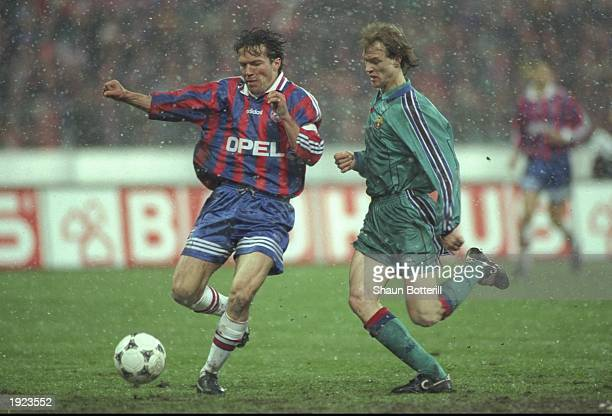 Lothar Matthaus of Bayern Munich takes on Jordi Cruyff of Barcelona during the UEFA Cup semifinal at the Olympic Stadium in Munich Germany Barcelona...