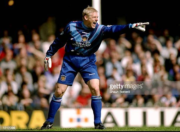 Manchester United goalkeeper Peter Schmeichel indicates to his team mates during an FA Carling Premiership match against Southampton at The Dell in...