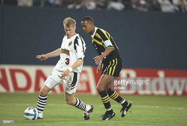 Matt Knowles of the New York/New Jersey MetroStars and Columbus Crew player Doctor Khumalo fight for the ball during a game at Giants Stadium in East...