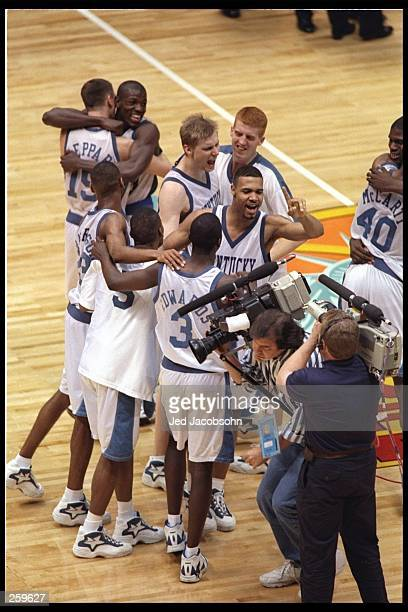 Members of the Kentucky Wildcats celebrates after winning the NCAA Championship against the Syracuse Orangemen at the Meadowlands in East Rutherford,...
