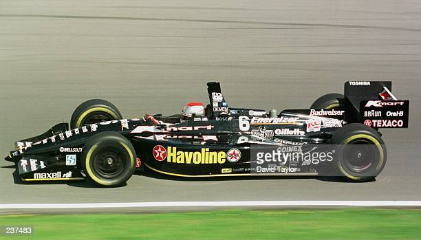 Michael Andretti takes his Newman Haas Racing Lola Ford T96/00 around the track during practice for round five of the PPG IndyCar World Series at...