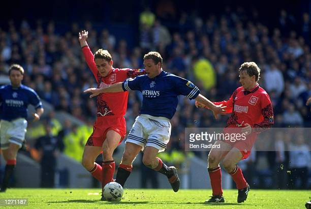 Paul Gascoigne of Rangers breaks through the Aberdeen defence during a match at Ibrox Stadium in Glasgow Scotland Mandatory Credit Ben...