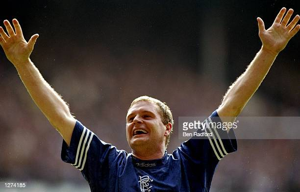 Paul Gascoigne of Rangers salutes the crowd during a match against Aberdeen at Ibrox Stadium in Glasgow Scotland Mandatory Credit Ben Radford/Allsport