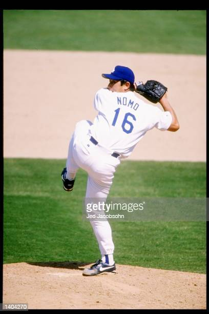 Pitcher Hideo Nomo of the Los Angeles Dodgers winds up for the pitch during a game against the Atlanta Braves at Dodger Stadium in Los Angeles,...
