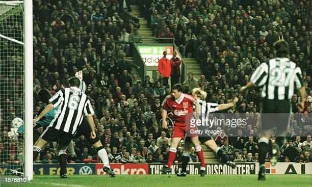 Robbie Fowler of Liverpool heads to score against Newcastle United in the first two minutes of their FA Premiership game at Anfield in Liverpool...