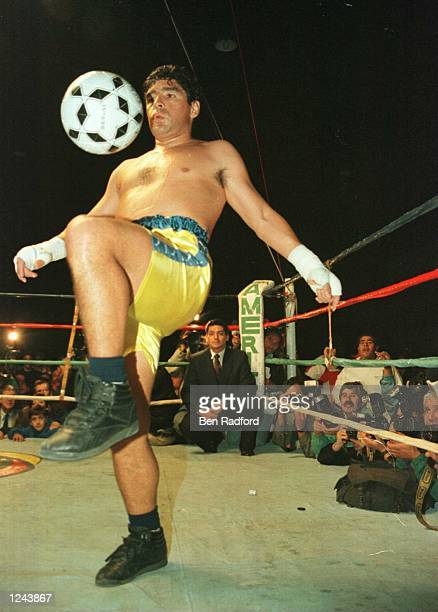 Soccer star Diego Maradona juggles a soccer ball in the ring at the end of a charity boxing match against Falucho Lacier former WBA Flyweight world...