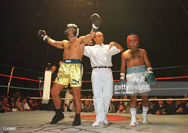 Soccer star Diego Maradona left acknowledges the crowd at the end of a charity boxing match against Falucho Lacier former WBA Flyweight world...