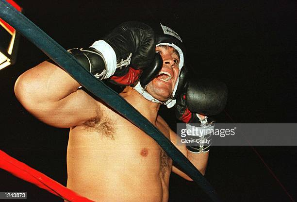 Soccer star Diego Maradona shouts to supporters before a charity boxing match against Falucho Lacier former WBA Flyweight world champion at the...