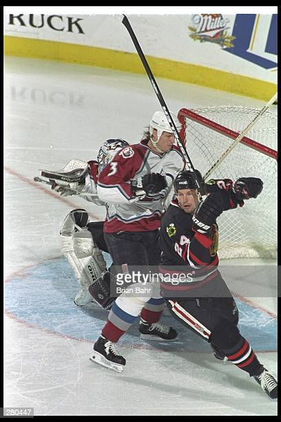 Bob Probert of the Chicago Blackhawks skates if front to the goal as Aaron  Miller of b4e6a8c98