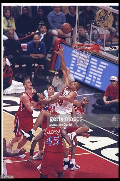 Brian Williams of the Chicago Bulls battles Adrian Caldwell of the Philadelphia 76ers for the rebound during the Bulls 8477 win at the United Center...