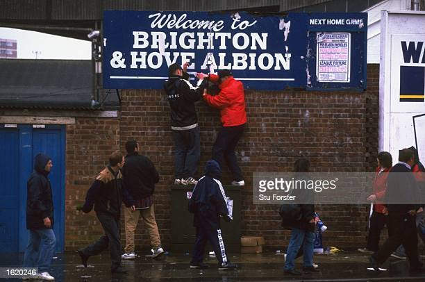 Brighton and Hove Albion fans hunting for memorabilia after the Division Three game against Doncaster Rovers which was the last game ever to be...