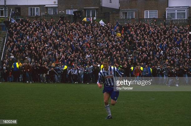 Brighton and Hove Albion fans invade the pitch on the referees final whistle of the Division Three match between Brighton and Hove Albion and...