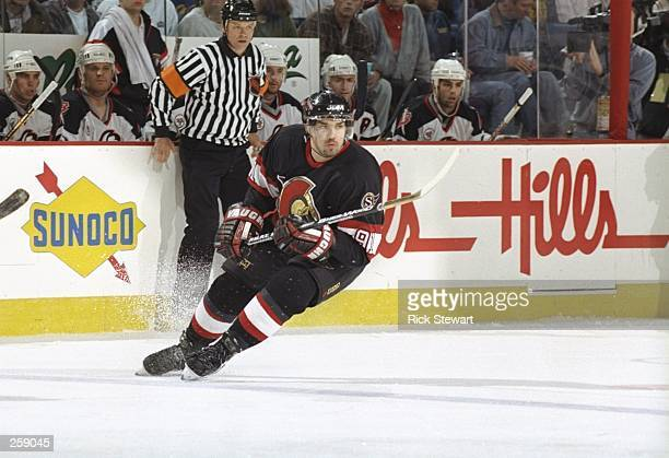 Center Alexandre Daigle of the Ottawa Senators skates down the ice during a playoff game against the Buffalo Sabres at the Marine Midland Arena in...