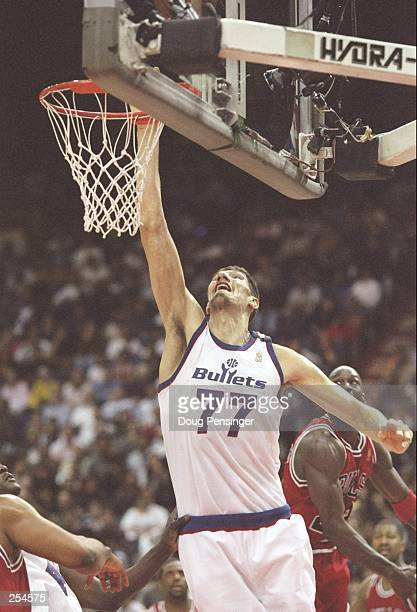 Center Gheorge Moresan of the Washington Bullets drives to the basket during a game against the Chicago Bulls at the US Air Arena in Landover...