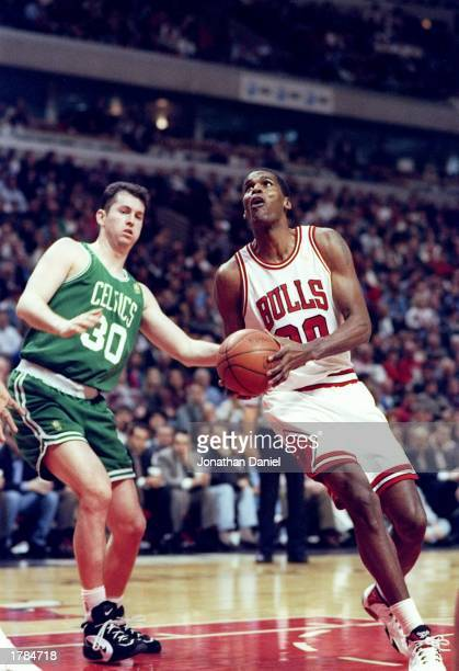 Center Robert Parish of the Chicago Bulls in action against Harry Conlon of the Boston Celtics during a game at the United Center in Chicago Illinois...