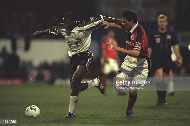 Dean Sturridge of Derby County holds off Steve Chettle of Nottingham Forest during the Carling Premier League match at the Baseball Ground in Derby...