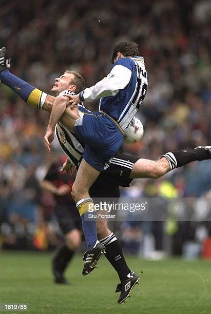 Dejan Stefanovic of Sheffield Wednesday challenges Alan Shearer of Newcastle United during the Premier League match at Hillsborough in Sheffield,...