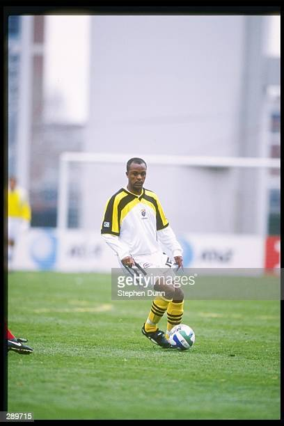 Doctor Khumalo of the Columbus Crew runs down the field with the ball during a game against Dallas Burn at Ohio Stadium in Columbus Ohio The Crew won...