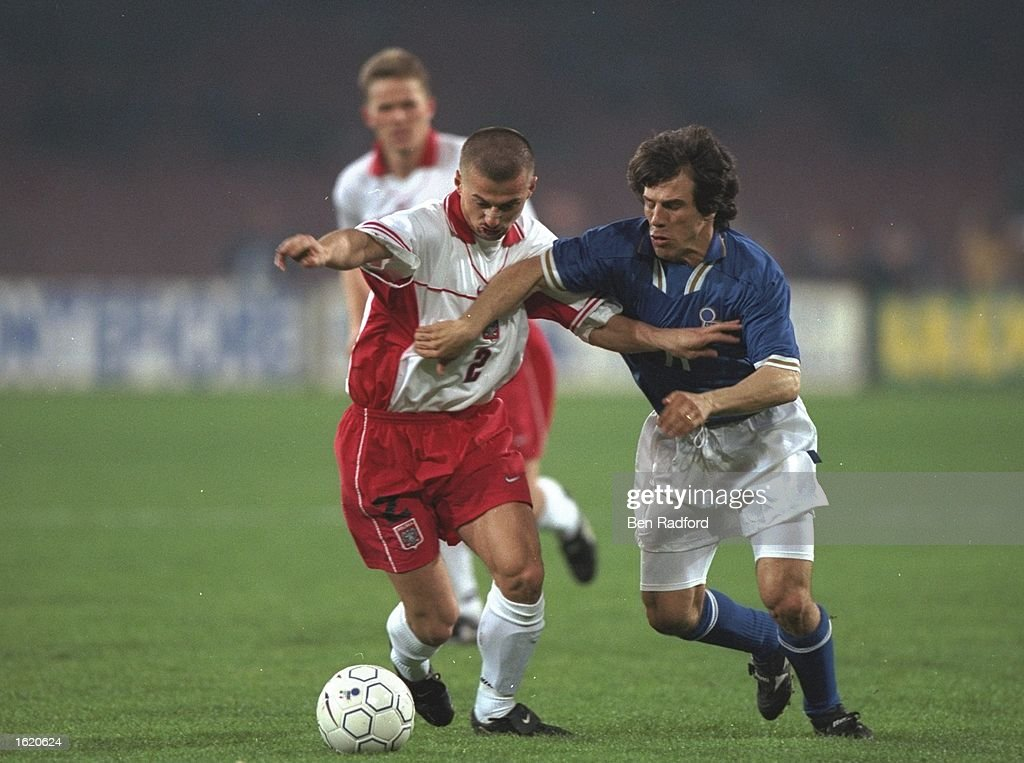 Gianfranco Zola (right) of Italy attempts to win the ball from Ledwon of Poland during the World Cup Qualifier in Naples, Italy. Italy won 3-0. \ Mandatory Credit: Ben Radford /Allsport