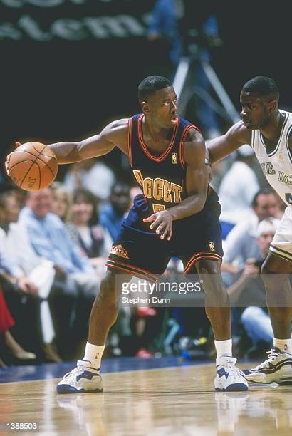 Guard Anthony Goldwire of the Denver Nuggets tries to fend off Michael Finley of the Dallas Mavericks at Reunion Arena in Dallas Texas The Nuggets...