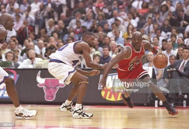 Guard Calbert Chaney of the Washington Bullets tries to guard guard Michael Jordan of the Chicago