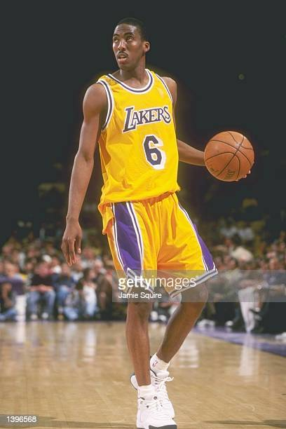 Guard Eddie Jones of the Los Angeles Lakers dribbles the ball down the court during a game against the Phoenix Suns at the Great Western Forum in...