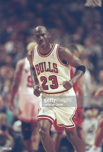 Guard Michael Jordan of the Chicago Bulls runs down the court during a game against the Washington Bullets at the United Center in Chicago, Illinois....