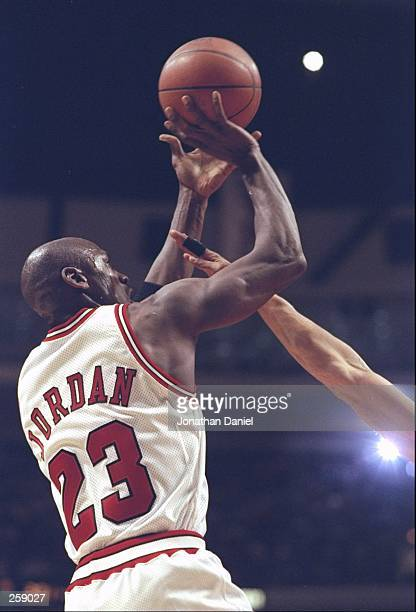 Guard Michael Jordan of the Chicago Bulls shoots the ball during a game against the Toronto Raptors at the United Center in Chicago Illinios The...