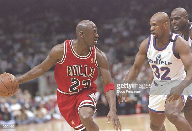 Guard Michael Jordan of the Chicago Bulls tries to drive past guard Jaron Jackson of the Washington Bullets during a playoff game at the US Air Arena...