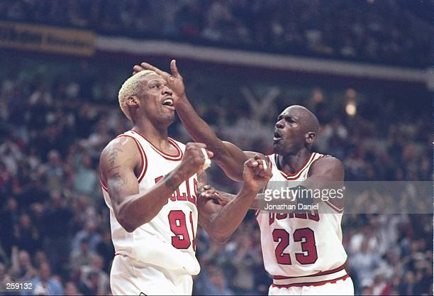 Guard Michael Jordan taps forward Dennis Rodman of the Chicago Bulls on the head during a playoff game against the Washington Bullets at the United...