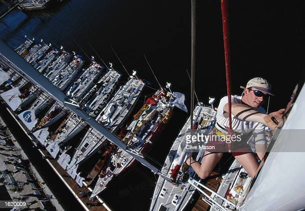 Jon Hirsh works on Ocean Rover's mast above the assembled BT Global fleet in Cape Town at the end of leg four of the BT Global Challenge Mandatory...