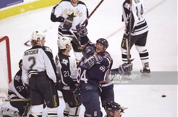 Kelly Buchberger of the Edmonton Oilers celebrates with teammate Ryan Smyth during the Oilers 53 loss to the Dallas Stars at Reunion Arena in Dallas...