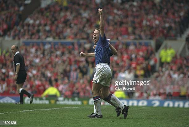 Kevin Davies of Chesterfield punches the air in triumph after a goal for Chesterfield in the FA Cup SemiFinal against Middlesbrough at Old Trafford...